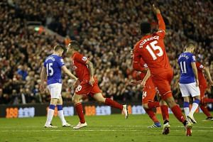Philippe Coutinho celebrates after scoring the fourth goal for Liverpool.