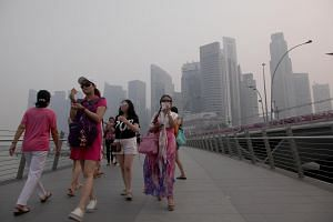 People walking on the street during a hazy day in Singapore on Sept 10, 2015.
