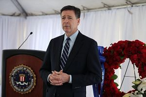 Federal Bureau of Investigation (FBI) director James Comey speaks to the media in Miramar, Florida, on April 11, 2016.