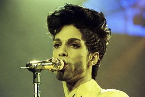 Prince performs during his Diamonds And Pearls Tour at the Earl's Court Arena in London on June 15, 1992.