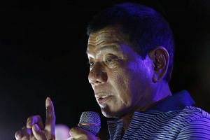 Filipino presidential candidate, Rodrigo Duterte, speaks to supporters at a campaign rally in Manila, on April 23, 2016.