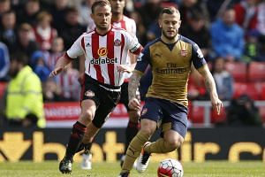 Arsenal's Jack Wilshere in action with Sunderland's Lee Cattermole on Sunday.