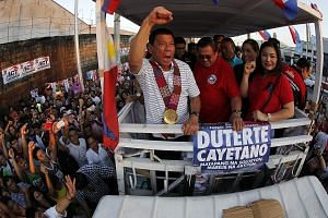 Mr Rodrigo Duterte whipping up the crowd during a campaign rally in Quezon City, east of Manila, on Saturday.