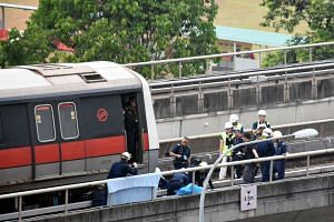 Paramedics from the Singapore Civil Defence Force at the accident site, where two SMRT staff were killed on the train track near Pasir Ris MRT station on March 22, 2016.