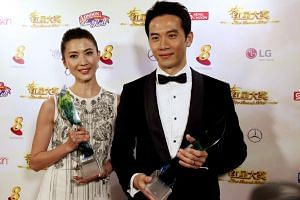 Jeanette Aw (left) and Qi Yuwu pose with their Best Actress and Actor awards at the Star Awards 2016.