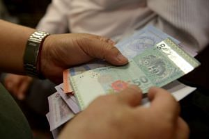 The ringgit declined 0.6 per cent to 3.9320 per US dollar as of 9.45am in Kuala Lumpur, according to prices from local banks compiled by Bloomberg.