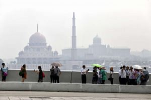 The Malaysian Prime Minister's office building is covered by haze in Putrajaya on April 22, 2016.