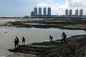 Activists and residents walk on reclaimed land during a protest against land reclamation in Jakarta Bay, Indonesia on April 17, 2016.