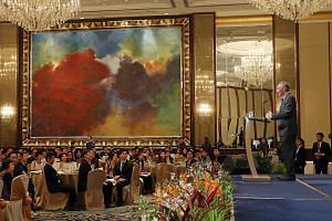 PM Lee giving his speech at last night's event at Shangri-La Hotel, where 65 administrative officers were promoted. Nine of them were among the 21 newly appointed officers.