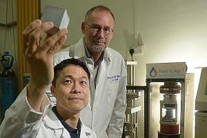 (Above) NauticAWT CEO, Mr Gronbech. (Left) NauticAWT's chief scientist Chia Kok Seng (front) and chief operating officer Elo Yde with a grout cube specimen.