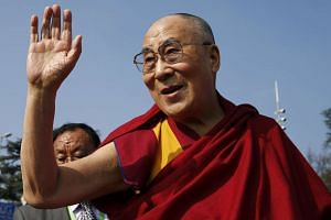 Chinese dissident Lu Jinghua's visa to travel to India to meet the Dalai Lama (pictured) was cancelled by New Dehli.