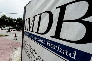 1MDB has been fined by Malaysia's central bank for failing to comply with bank rules.