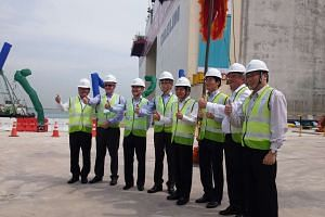 Mr Andrew Tan (third from left), CEO of MPA, and Minister for Transport Khaw Boon Wan (fifth from left), with representatives from Daelim Industrial and Dredging International Asia Pacific at the launch of the first caisson at Tuas Terminal.