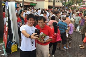 SDP chief Chee Soon Juan greeting Bukit Batok residents during the party's walkabout on Sunday (May 1).
