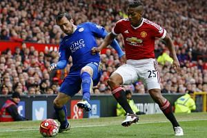 Leicester City's Christian Fuchs in action with Manchester United's Antonio Valencia on May 1, 2016.