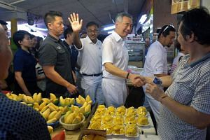 PM Lee Hsien Loong (third from right) during a walkabout in Bukit Batok with Mr Murali Pillai (fourth from right).