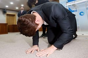 South Korean swimmer Park Tae Hwan makes a formal deep bow at a press conference in Incheon, to express his regret for doping, on May 2, 2016.