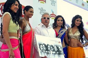 """Often photographed with models and Bollywood stars, Mr Mallya cultivated an image much like the slogan for his Kingfisher beer - """"King of the Good Times""""."""