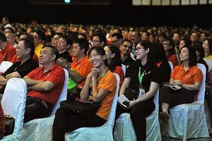 The audience at the May Day Rally held at D'Marquee, Downtown East yesterday. PM Lee said the Government's approach is to ensure a more level playing field and help industries and firms compete better.