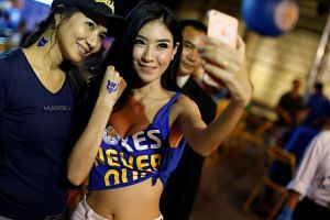 Leicester City fans takes pictures while watching the game against Manchester United on a big screen in Bangkok on Sunday night.