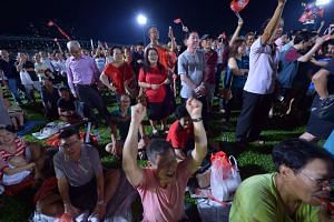 Rally-goers at Bukit Gombak Stadium last night. In a 50-minute speech, Dr Chee outlined previously announced plans for Bukit Batok and listed some national issues he hopes to take up in Parliament if elected.