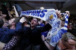 Leicester City fans celebrate winning the Premier League.