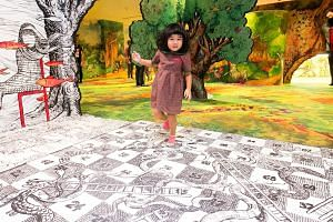 Children step into the pages of a giant storybook at the Keppel Centre for Art Education.