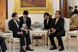 Japan's Foreign Minister Fumio Kishida (left) meeting Thai Prime Minister Prayut Chan-o-cha at Government House in Bangkok. Mr Kishida urged Asean countries to adhere to three principles of the rule of law at sea in order to maintain peace and stabil