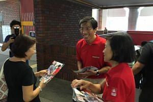 Dr Chee (centre) on a walkabout at Bukit Batok MRT on May 3.