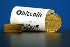 File photo of a Bitcoin (virtual currency) paper wallet with QR codes and a coin.