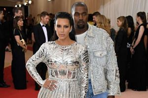 Kim Kardashian West (left) and Kanye West attending the Manus x Machina: Fashion In An Age Of Technology Costume Institute Gala at Metropolitan Museum of Art on May 2, 2016, in New York City.