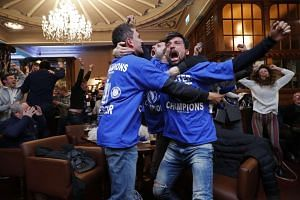 Leicester City fans celebrate Chelsea's second goal at pub in Leicester.