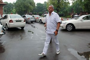 Vijay Mallya arrives at Parliament House in New Delhi in a photo taken in 2013.