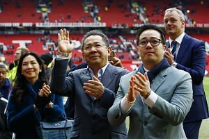 Leicester City chairman Vichai Srivaddhanaprabha (centre) at the end of the game.