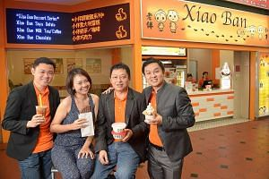 Tai Sei Hei's management staff comprising (from left) Mr Max Yeow, Ms Esther Yan, Mr Ken Li and Mr Terrence Hong. Mr Yeow credits IE Singapore for steering the company - which produces soya beancurd under the brand Lao Ban - towards Vietnam. It has a