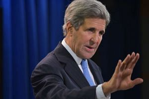 US Secretary of State John Kerry answers a question on Syria while speaking in the briefing room of the State Department in Washington on May 3, 2016.