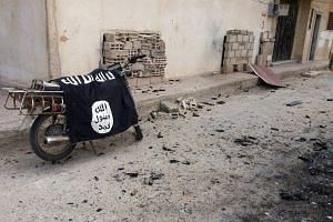 An Islamic State flag is seen on a motorbike in Palmyra, Syria.