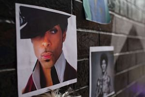 Photos of Prince at a memorial created by fans at the First Avenue nightclub in Minneapolis, Minnesota.