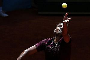 Australia's Nick Kyrgios serves against Stanislas Wawrinka of Switzerland during his 7-6 (9-7), 7-6 (7-2) win in the second round of the Mutua Madrid Open tennis tournament yesterday.
