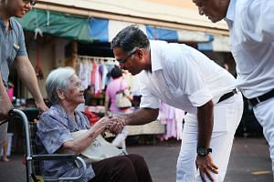 People's Action Party's candidate for Bukit Batok by-election Mr Murali Pillai greets a resident on a walkabout at Bukit Batok West Avenue 6.