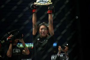 Mixed martial artist Angela Lee (above) made history as she beat Japan's Mei Yamaguchi in One Championship's first-ever women's title fight.