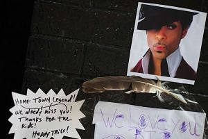 """The preference of Prince (pictured above, in a fan memorial) was for """"quiet philanthropy""""."""