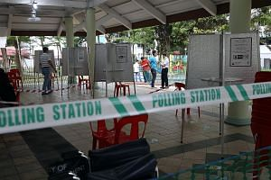 Barricades and voting booths at the polling station at the void deck of Block 105A, Bukit Batok Central, yesterday, ahead of Polling Day today. Voters can cast their ballots from 8am to 8pm.