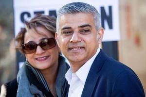 Khan and his wife Saadiya pose for photographers after voting in polls in London on May 5, 2016.