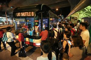 Commuters taking a free shuttle service at Choa Chu Kang LRT station in March last year when the Bukit Panjang LRT was shut down after a fire.
