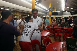 Mr Murali being congratulated at a coffee shop in Bukit Batok after his by-election win yesterday.