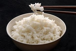 Starchy white rice has a high carbohydrate content which is broken down by the body to become sugar.