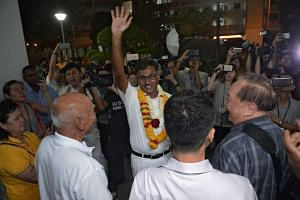 Mr Murali Pillai celebrates with supporters after winning the by-election