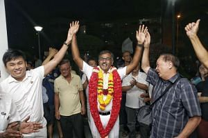 PAP's Murali Pillai waving to residents and supporters outside the PAP's Bukit Batok branch office after the announcement of his win in the by-election.