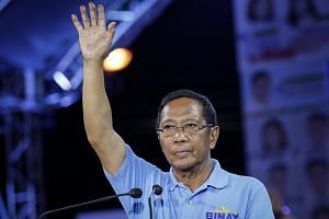 "Vice-President Jejomar Binay waves during his ""miting de avance"" in Makati city, south of Manila, Philippines on May 7, 2017."